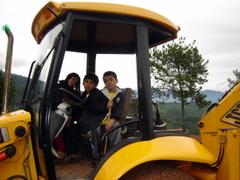 Naik Traktor